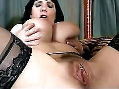 Busty mom plays with her big boobs