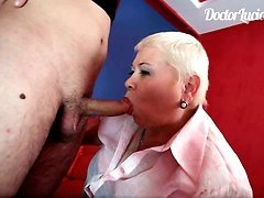 Big momma's tongue sliding all over tattooed dude's cock