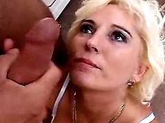 Older blonde taking in ass on floor