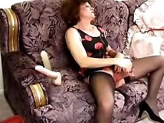 Old housewife tests her new dildos