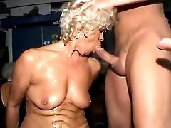 Granny sucking cocks in gangbang