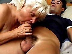 Blond granny sucks cock
