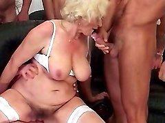 Guys screw mom in orgy