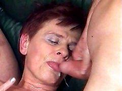 Granny eats cum in orgy