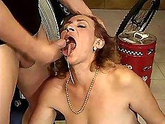 Depraved mom fucks in car workshop and gets facial
