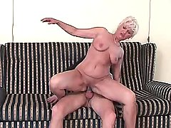 Blonde aged mature sucks and jumps on cock on sofa