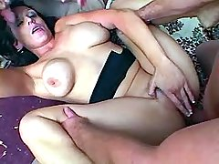 Slutty mom enjoys two dicks in her cunt and mouth