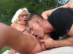 Older granny titty fucks a young buck