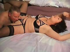Slutty mature spreading her legs in stockings