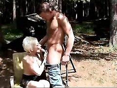 Mature sucks and has fuck outdoor