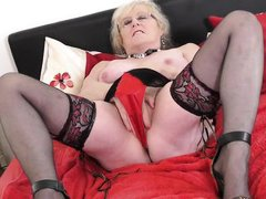 horny granny with big tits finger-fucks her wet pussy