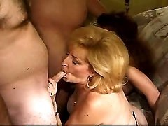 Two lewd matures fuck in hard orgy